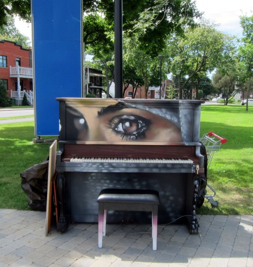 Public piano (and grocery cart) at Parc Beaudet in St. Laurent, just outside the du College station
